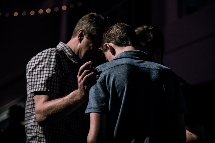 members praying for each other